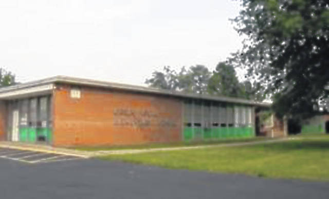 Photo of Green Elementary, displaying the only air system, window air conditioners