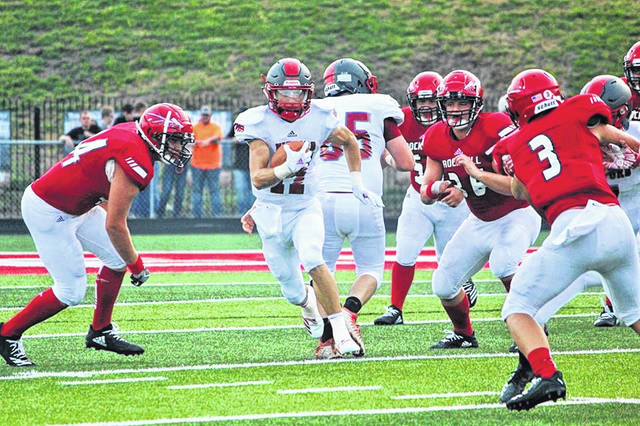 Minford quarterback Kelton Kelley and his team prepare for SOC II and county rival Portsmouth West.