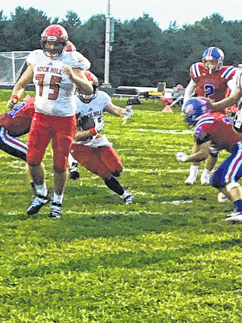 Mohawk defenders attempt to tackle a Rock Hill rusher in their defeat Friday night, 33-0 in McDermott.