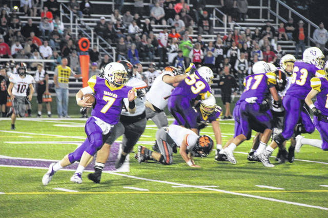 Valley senior quarterback Andrew Shope scrambles in the first half of the Indians home loss to the Waverly Tigers, 35-28.