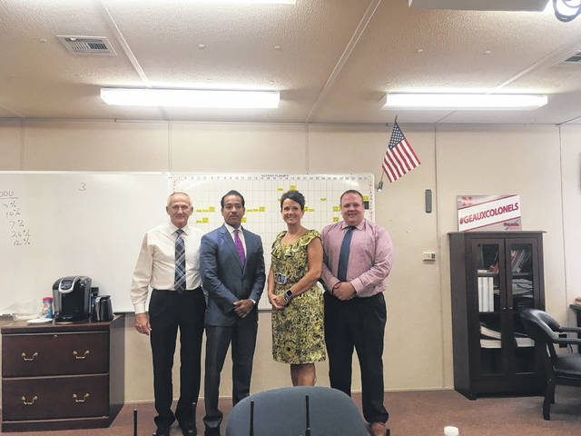 (l to r)Rick Bowman, Victor Woods, Foresta Shope and Corey Ruby, part of a group that got together to come up with a way to help get Sciotoville Schools a new school.