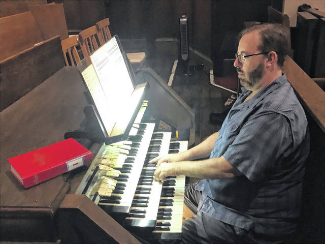 Stan Workman shows off some of the capabilities of the massive organ at Second Presbyterian prior to a concert over the summer.