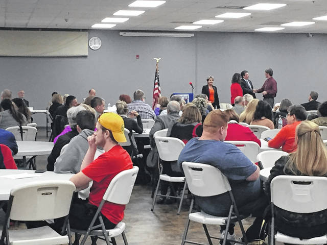A modest crowd gathered Tuesday evening for the League of Women Voters' Meet the Candidates. In the background Scioto County Commissioner candidates Bryan Davis and Trampas Puckett shake hands prior to the forum.