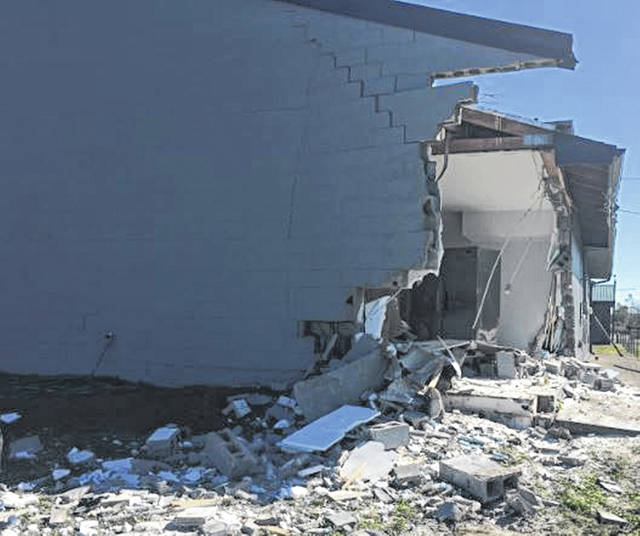 A tractor Trailer ran through a building on SR 104 near the intersection of SR 348 Monday. No injuries were reported.