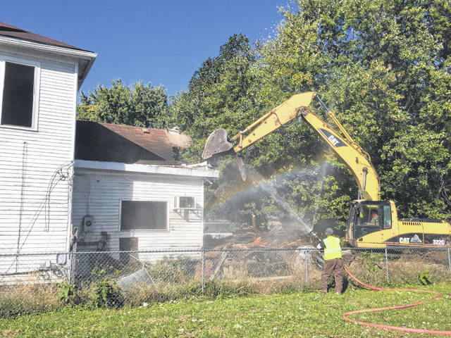 527 7th Street began demolition on Tuesday morning.