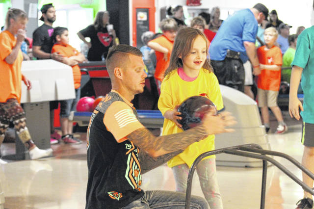The Just 4 Fun bowling league began their year of play Saturday afternoon at Sunset Lanes in Portsmouth.