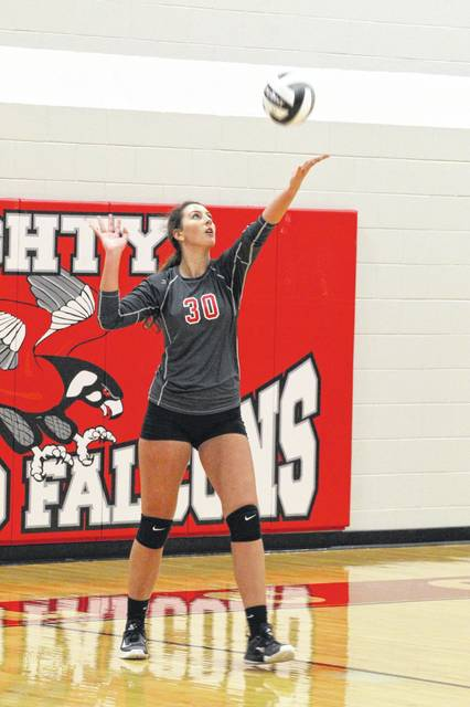 Minford senior Ally Coriell prepares to serve in the Falcons three set victory over Portsmouth Tuesday night.