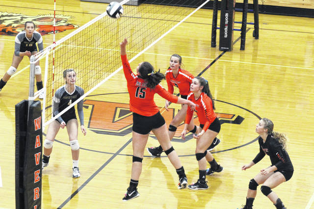 Wheelersburg sophomore Emily Boggs gets the ball over the net in the Pirates district semifinal matchup vs. South Point Tuesday evening.
