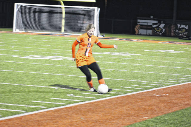 Wheelersburg freshman Allie Vallance handles the ball for the Lady Pirates.