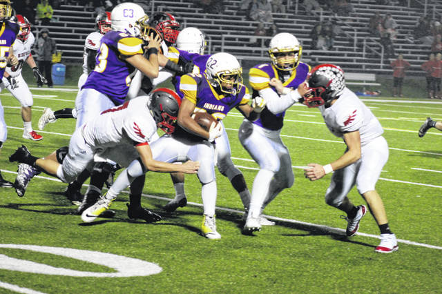 Senior running back Gabe Streeter carries the ball in Valley's 42-14 win over Minford Friday night.
