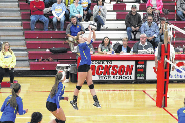 Delanie Gilliland gets the ball across the net in Clay's straight set district championship win over Eastern Saturday afternoon.