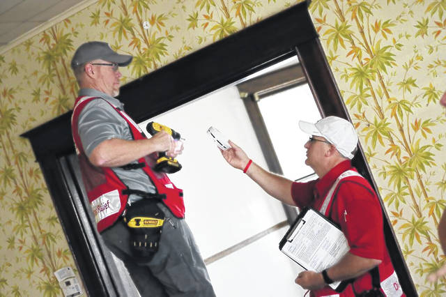 Local volunteers for The American Red Cross, installing smoke alarms