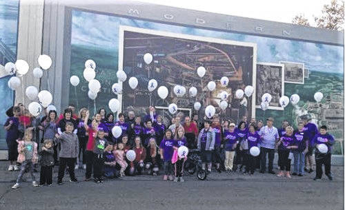 Participants in last year's Alpha-1 Walk release balloons in honor of persons lost to the disorder.
