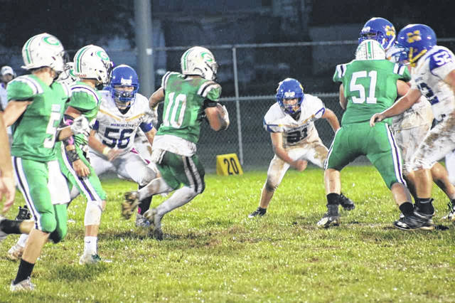 Green running back Alec Smith carries the ball in the Bobcats senior night victory against Manchester.
