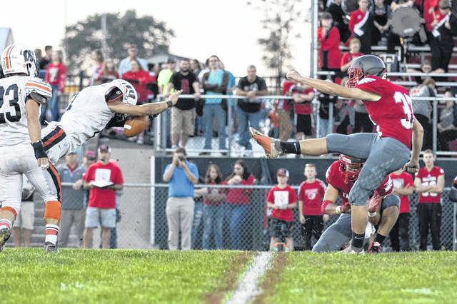 Trevor Staggs blocked a Minford field goal attempt in the first half of last Friday nights contest between the Falcons and Senators.