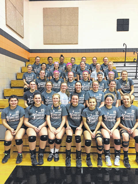 Players from Wheelersburg, Portsmouth, and North Adams wear their spike out cancer shirts during Saturday's tri-match between the three schools.