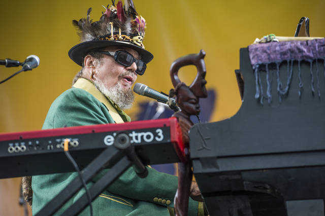 In this April 30, 2017 file photo, Dr. John performs at the New Orleans Jazz and Heritage Festival in New Orleans. The New Orleans-born musician celebrated his 77th birthday last Nov. 21 in the French Quarter. But he was apparently a year early. Publicist Karen Beninato said she looked into it after talking to friends and relatives of the Rock & Roll Hall of Famer.