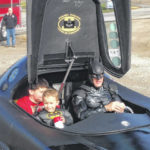 Two boys get Hope Injections from Batman