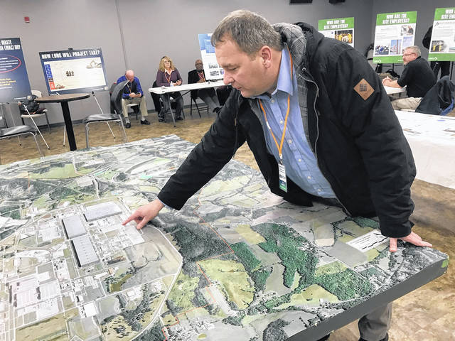 Jeff Pinkerton of Flour BWXT makes some points using a model of the Piketon plant site.