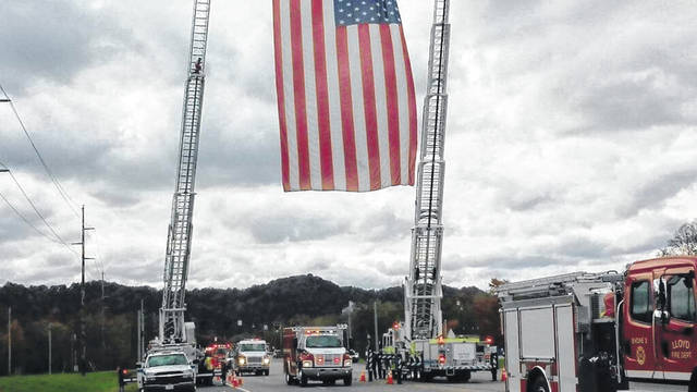 Fire departments from all over Kentucky, as well as southern Ohio escort fellow fire fighter Robert Helton to his final resting place. Helton suffered a fatal heart attack while giving assistance at an automobile accident.