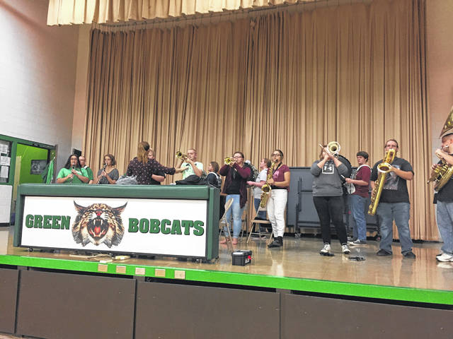 The Green Local Pep Band playing for the pep assembly