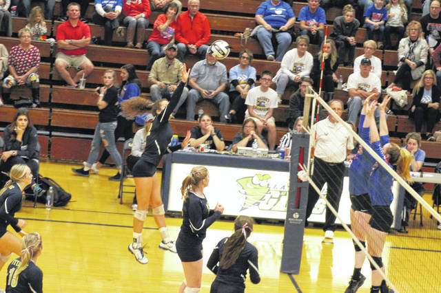 Notre Dame senior Clara Hash attempts a kill in the Lady Titans regional semifinal victory over Fort Frye.