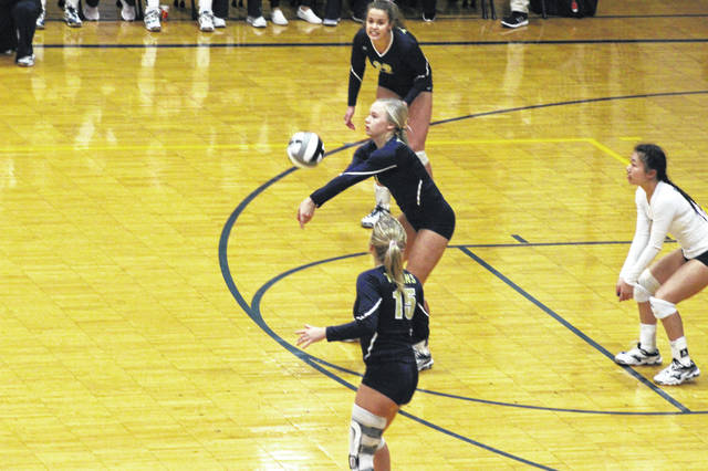 Notre Dame junior Taylor Schmidt receives the ball in the Lady Titans loss to Clay Saturday afternoon.