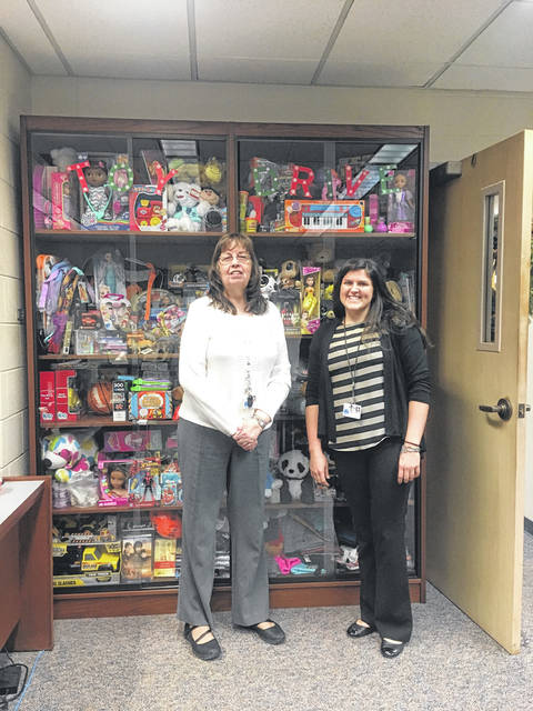 (left to right) Carolyn Cottrell and Katie Williams stand in front of the toy display