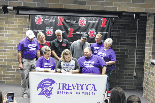 Cook officially signs her letter of intent to play college basketball at Trevecca Nazarene University Wednesday afternoon.