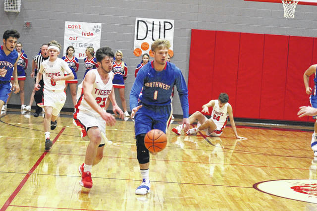Northwest's Billy Crabtree dribbles up the court in the Mohawks season opening loss to Glenwood Friday night.
