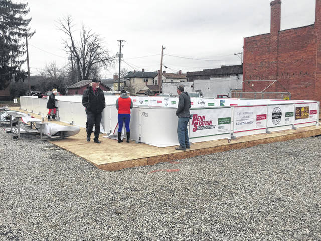 Friends of Portsmouth were busy putting the final touches on the ice skating rink at Second and Market streets in downtown Portsmouth this week. The skating rink will remain up throughout Portsmouth's Winterfest activities which begin Saturday.