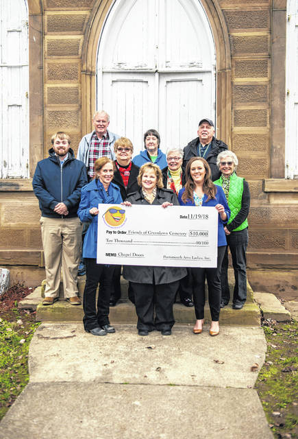 PALS and Freiends of Greenlawn Cemetery with the check in front of the chapel: Front Row -(l to r) Melissa Appleton, Debbie Gambill, Jill Arnzen Middle Row - Tanner Hatcher, Tess Midkiff, Julia Wisenski, Betty Kennedy Back Row - Rev. John Gowdy, Linda Donaldson, Bob Gambill