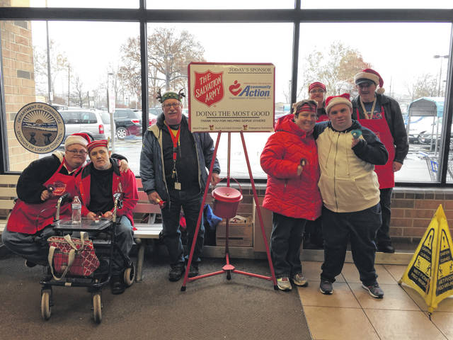 Keith Chatfield had the Impact Team of STAR Adult Services busy ringing bells for the Portsmouth Salvation Army Tuesday afternoon at Portsmouth Kroger. Pictured from left, are: Daniel, David, Chatfield, Jessica, Neal; back row: Tina and Tommy.
