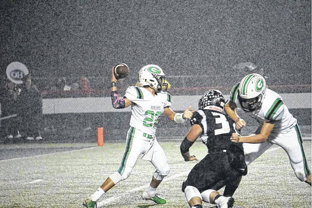 Bobcats quarterback Trevor Darnell drops back for a pass attempt in Green's final regular season contest with Oak Hill a week ago.