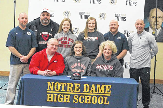 Saint Francis university signee and Notre Dame senior Katie Detwiller with family members, coaches, and administrators at her signing ceremony Tuesday.