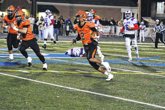 Wheelersburg wide receiver Tanner Holden caught a screen pass over the middle of the field and went 61 yards for a touchdown in the Pirates regional semifinal game with Jamestown Greeneview.
