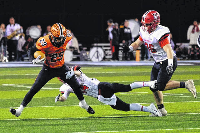 Wheelersburg playmaker Makya Matthews attempts to break a tackle in the Pirates regional final win over Madison on Saturday.