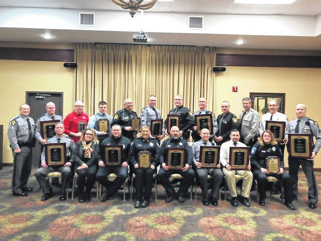 Portsmouth Police Chief Robert Ware, back row, second from end on the right, was among those law enforcement leaders to receive a platinum safety award from AAA.