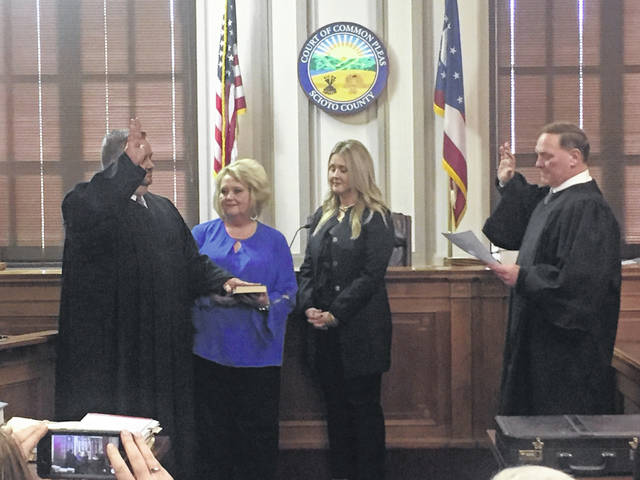 (Left to right) Judge Jerry Buckler, Lisa Buckler, Adrienne Buckler, and Judge Howard Harcha III.