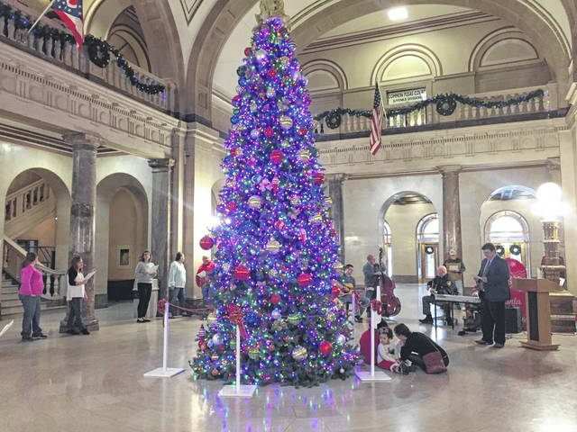 People gatheredat the Scioto County Courthouse to take part in a Christmas sing-a-long.