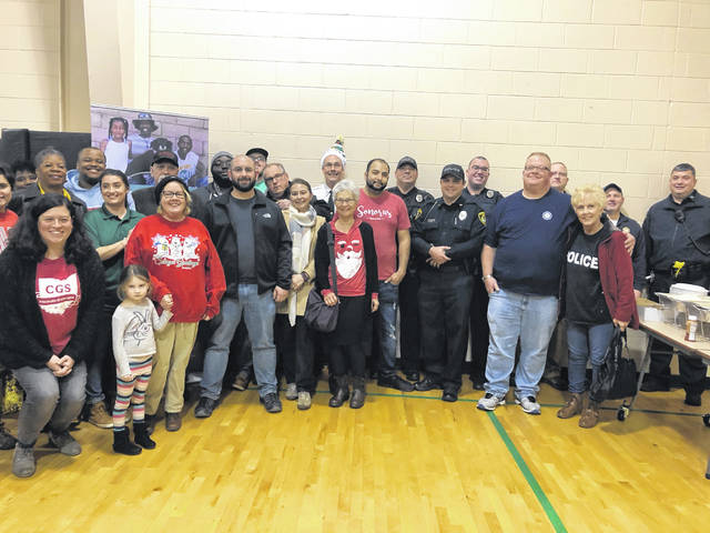 Chief Robert Ware (Center Back Row) along with Drew Carter and representatives from Sonoras and Patties and Pints, 14th Street CC board members, members of the Portsmouth Police and Fire Departments, and others who came to volunteer for the event.