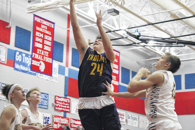 Valley's Mason Zaler scores during the first half of Fridays' 59-44 loss to South Point at Portsmouth High School.