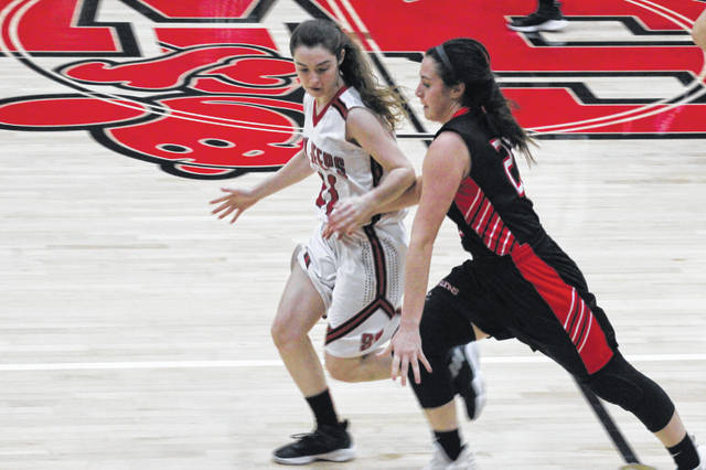 Kelsie Montgomery goes for a steal in the Lady Jeeps win over Fairfield on Saturday.
