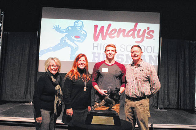 Notre Dame senior Simon Harting received a $500 college scholarship courtesy of Wendy's at the Wendy's High School Heisman ceremony on Tuesday.