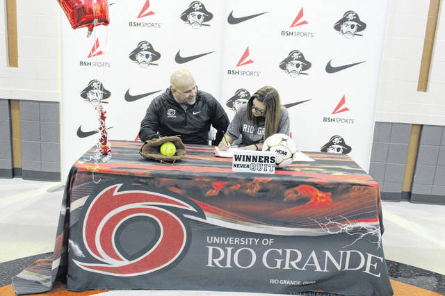 Wheelersburg senior Christen Risner signed her LOI with Rio Grande University with plans to play soccer and softball for the Red Storm beginning next fall.