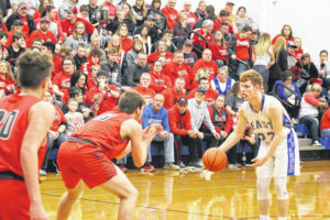 Tigers get road win over rival Tartans