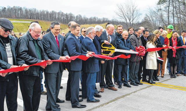 State officials, construction managers and local high school students line up at the entrance of the brand new SR 823 Thursday afternoon for the official ribbon cutting ceremony. A large crowd gathered and afterward, took a tour of the highway that links Lucasville to Wheelersburg, bypassing Portsmouth.