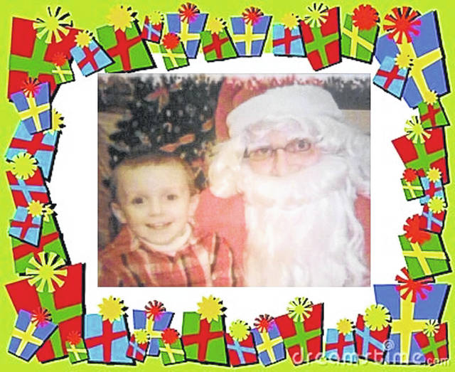 Tate with Santa before Tate became ill.