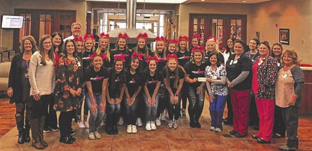 The Valley High School Cheerleaders in the middle, along with staff and others at the SOMC Cancer Center, donating the money they raised