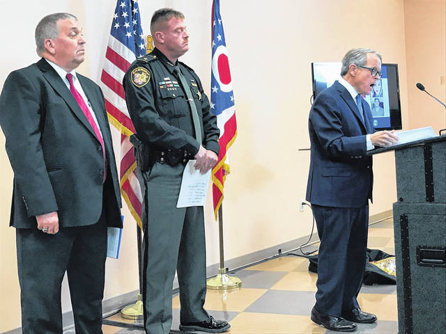 With Ohio Attorney General Mike DeWine at the podium, Pike County Sheriff Charlie Reader, center, is joined by Pike County Prosecutor Rob Junk during last month's press conference on the long awaited arrests in the Rhoden murders.